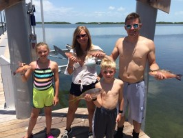 Another happy family after their charter trip on the Reel Sharp Sportfishing boat